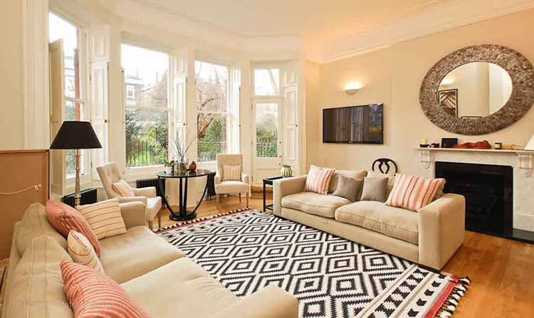 tạo không gian phòng khách bằng thảm